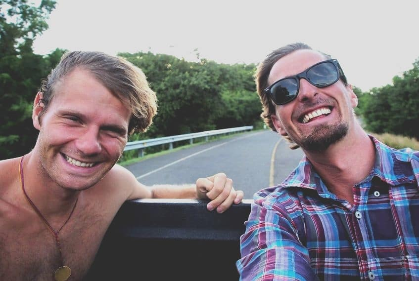 happy guys from traveling lifestyle