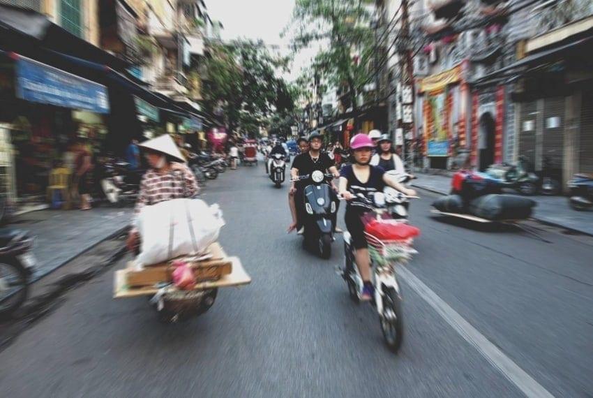 crossing a street in vietnam