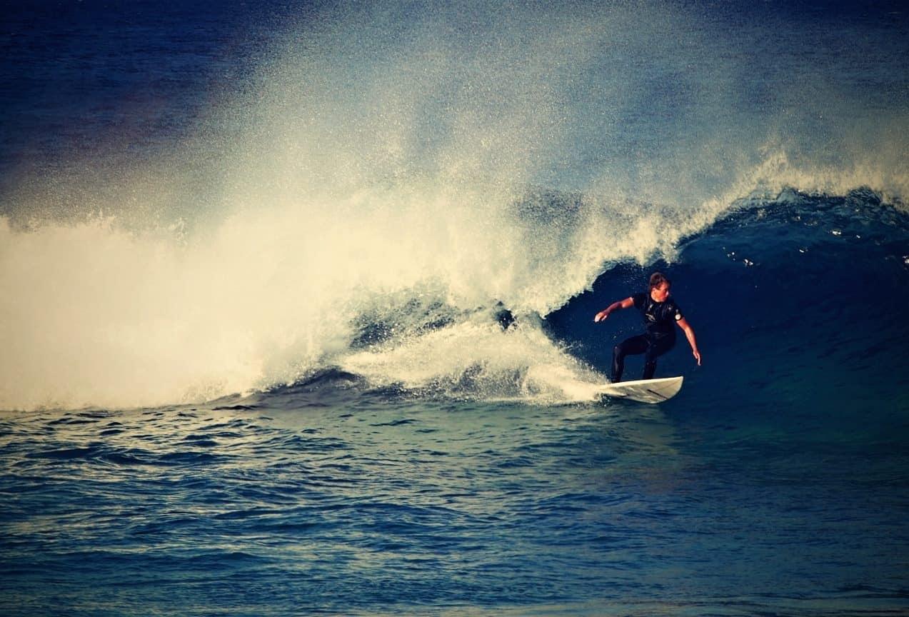 guy surfing the wave in sydney bondi beach